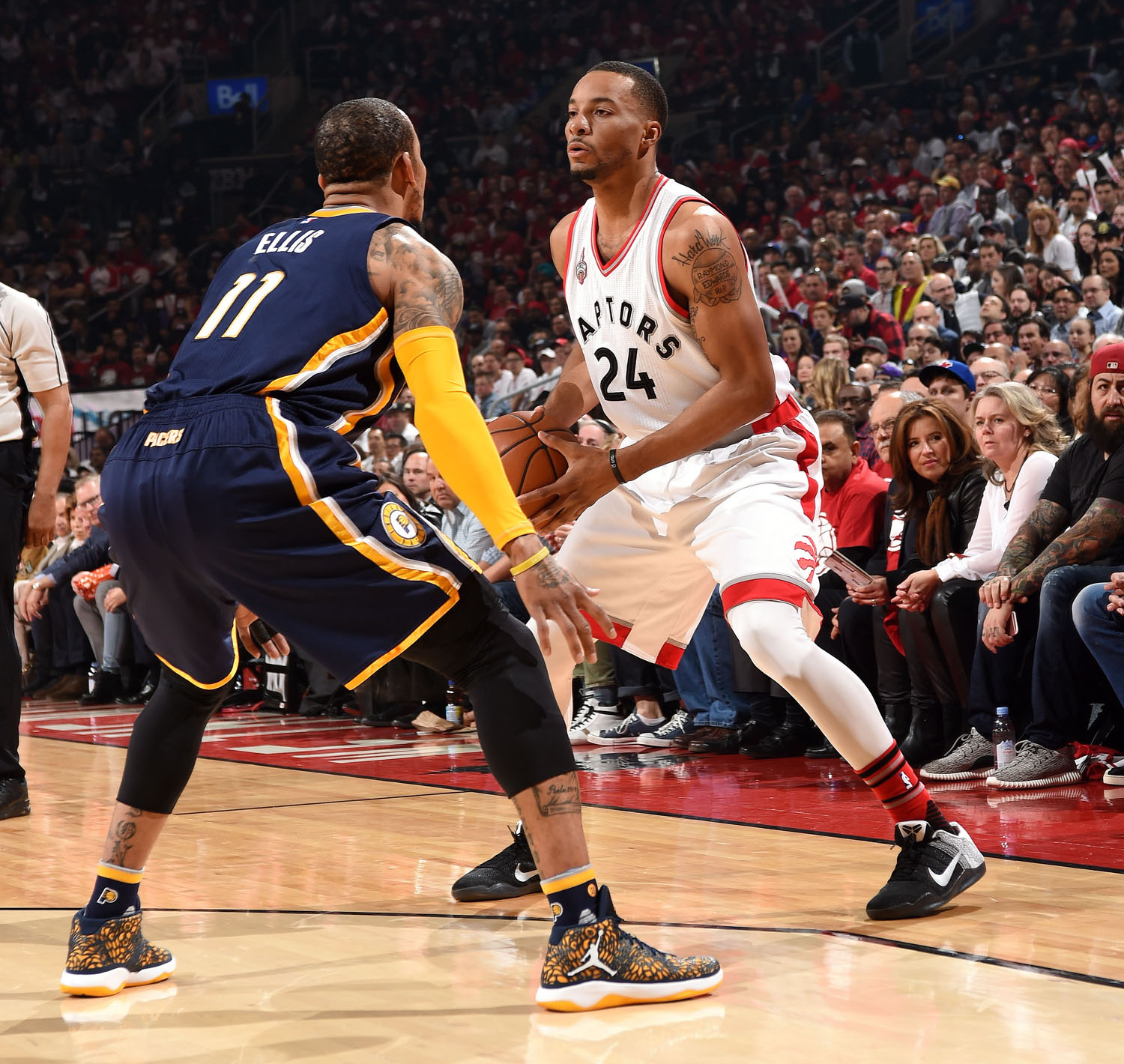 TORONTO, CANADA - APRIl 16: Norman Powell #24 of the Toronto Raptors handles the ball during the game against Monta Ellis #11 of the Indiana Pacers in Game One of the Eastern Conference Finals during the 2016 NBA Playoffs on April 16, 2016 at the Air Canada Centre in Toronto, Ontario, Canada.  NOTE TO USER: User expressly acknowledges and agrees that, by downloading and or using this Photograph, user is consenting to the terms and conditions of the Getty Images License Agreement.  Mandatory Copyright Notice: Copyright 2016 NBAE (Photo by Ron Turenne/NBAE via Getty Images)