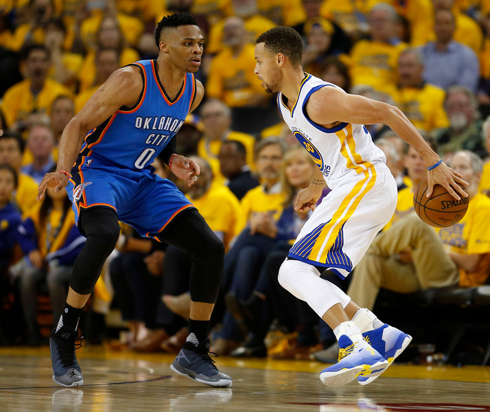 Golden State Warriors' Stephen Curry (30) dribbles against Oklahoma City Thunder's Russell Westbrook (0) in the third quarter of Game 1 of the NBA Western Conference finals at Oracle Arena in Oakland, Calif., on Monday, May 16, 2016. (Nhat V. Meyer/Bay Area News Group)