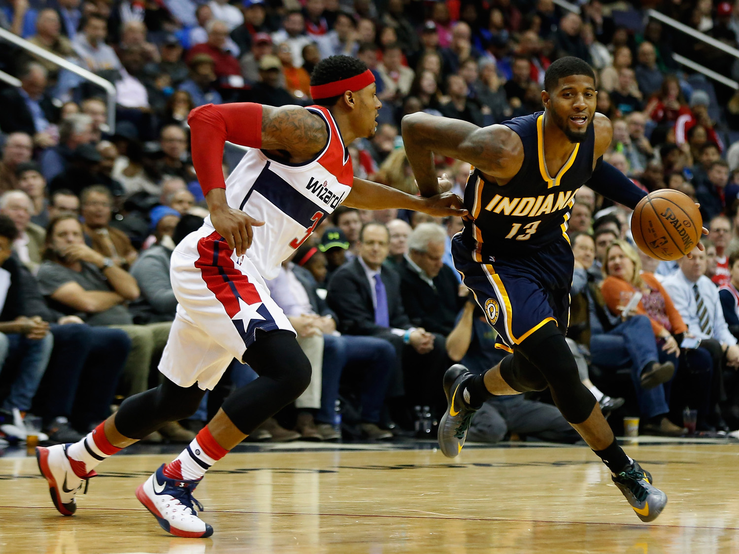 WASHINGTON, DC - NOVEMBER 24:  Paul George #13 of the Indiana Pacers drives around Bradley Beal #3 of the Washington Wizards in the second half at Verizon Center on November 24, 2015 in Washington, DC. NOTE TO USER: User expressly acknowledges and agrees that, by downloading and or using this photograph, User is consenting to the terms and conditions of the Getty Images License Agreement.  (Photo by Rob Carr/Getty Images)